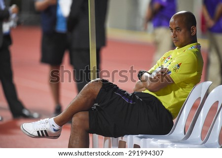 BISHAN,SINGAPORE-JUNE1:Head coach Choketawee Promrut of Thailand in action during the 28th SEA Games Singapore 2015 match between Thailand and Timor Leste at Bishan Stadium on JUNE1 2015 in,SINGAPORE. - stock photo