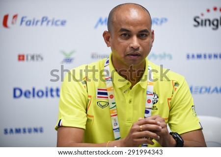 BISHAN,SINGAPORE-JUNE1:Head coach Choketawee Promrut of Thailand speaks during a press conference at Bishan Stadium on JUNE1 2015 in,SINGAPORE. - stock photo