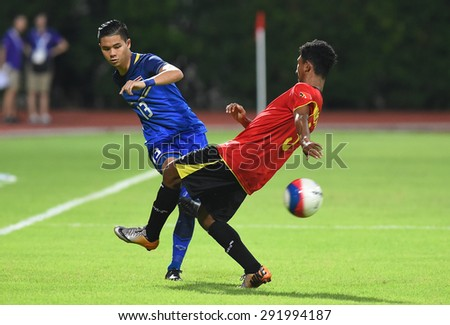 BISHAN,SINGAPORE-JUNE1: Narubadin Weerawatnodom(13) of Thailand in action during the 28th SEA Games Singapore 2015 match between Thailand and Timor Leste at Bishan Stadium on JUNE1 2015 in,SINGAPORE - stock photo