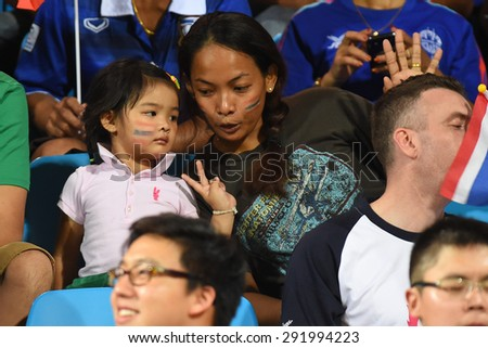 BISHAN,SINGAPORE-JUNE1:Unidentified Thai Fans in action during the 28th SEA Games Singapore 2015 match between Thailand and Timor Leste at Bishan Stadium on JUNE1 2015 in,SINGAPORE. - stock photo