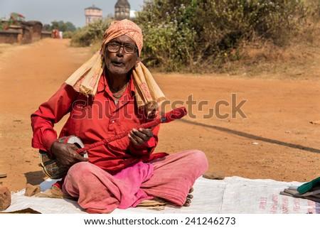 BISHNUPUR, INDIA - DECEMBER 20: A Baul - Indian folk singer performs in front of Jorbangla temple on December 20, 2014 in Bishnupur, West Bengal, India. - stock photo