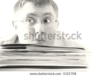Bisness man Drowning in paper - stock photo