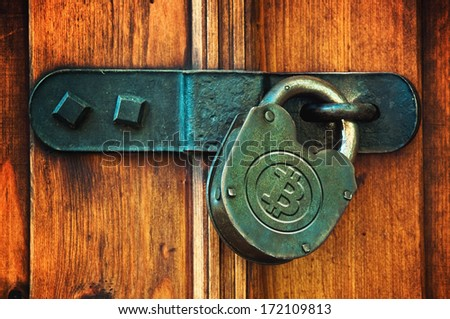 Bitcoin currency symbol on old metal padlock, safety concept. - stock photo