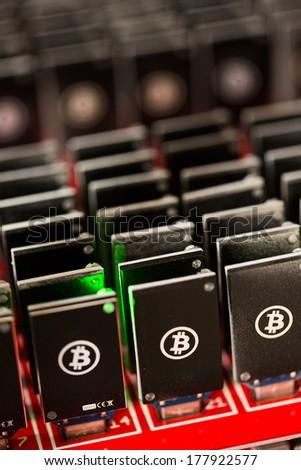 Bitcoin mining USB devices on a large USB hub. - stock photo