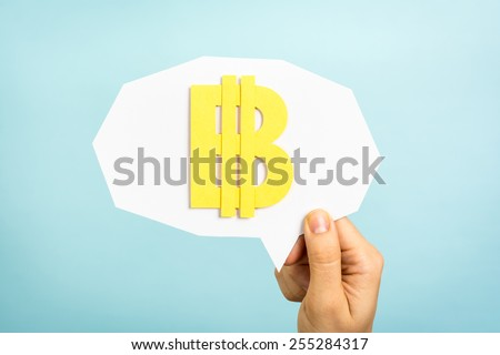 Bitcoin sign/symbol, virtual currency/money on speech bubble and blue background. - stock photo