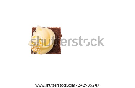 Bite sized chocolate cake with cream cheese toppings over white background  - stock photo