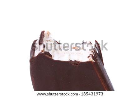 Bitten chocolate vanilla ice cream. Isolated on a white background. - stock photo