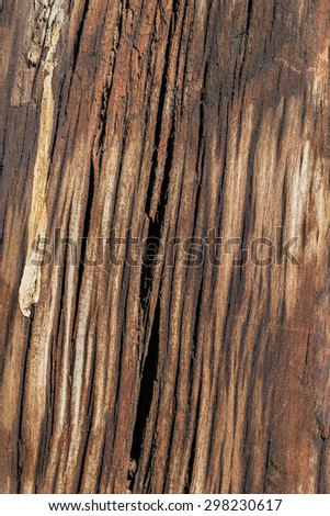 Bituminous rough surface texture of an old weathered, rotten, cracked Square Timber Bollard, made of obsolete, scrapped Railroad Cross Tie Timber, with bird droppings traces. - stock photo