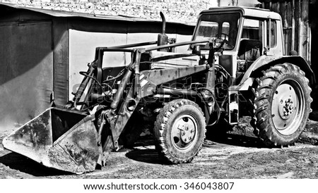 BIYSK, RUSSIA - MAY 29:Front end loader at the city street, 29 may 2010 on Biysk, Russia. Grunge - stock photo