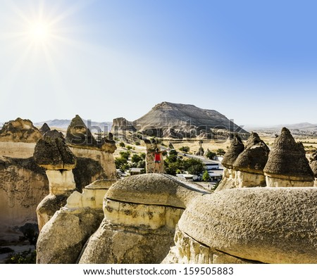 Bizarre rock formations of volcanic Tuff and basalt in Cappadocia, Turkey - stock photo