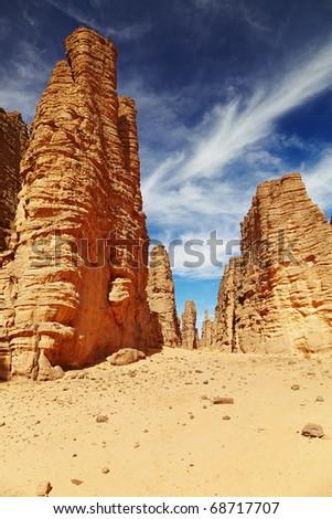 Bizarre sandstone cliffs in Sahara Desert, Tassili N'Ajjer, Algeria - stock photo