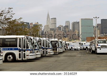 Bkln bus depot with NYC skyline - stock photo