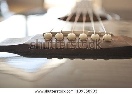 black acustic guitar close up with strings - stock photo