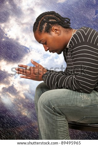 Black African American Christian man in deep prayer - stock photo