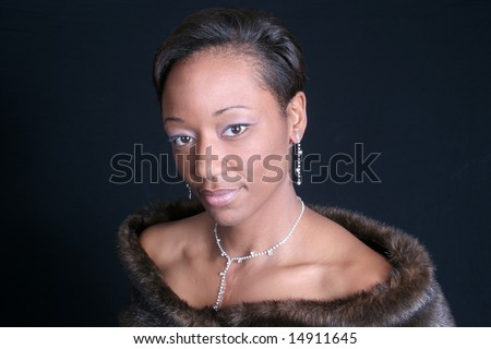 Black African American mature woman in a fur stole - stock photo