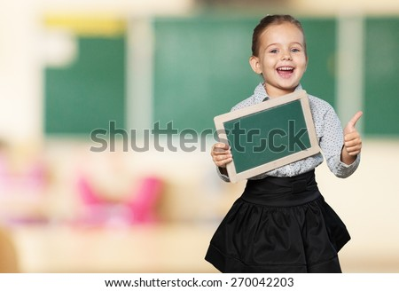 Black. African American school boy holding a blank  black board, isolated on white background - Black people - stock photo