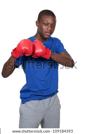 Black African American teenage boy athletic boxer with boxing gloves - stock photo