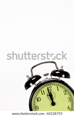 Black alarm clock isolated in bottom right corner - stock photo