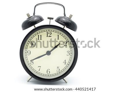 Black alarm clock isolated on white, - stock photo