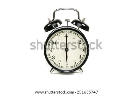 Black alarm clock isolated on white background. - stock photo