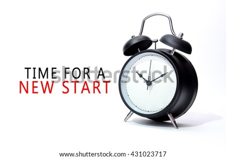 Black alarm clock isolated on white background with word Time For A New Start. Concept of Time. - stock photo