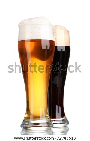 black and golden beer in glasses isolated on white - stock photo