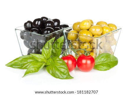 Black and green olives and tomatoes with basil. Isolated on white background - stock photo