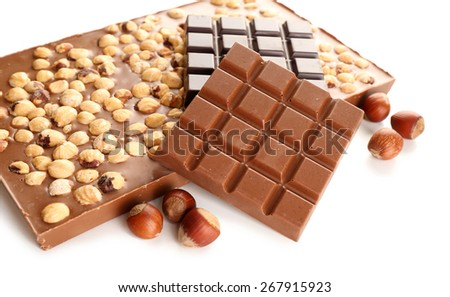 Black and milk chocolate bars with hazelnuts isolated on white - stock photo