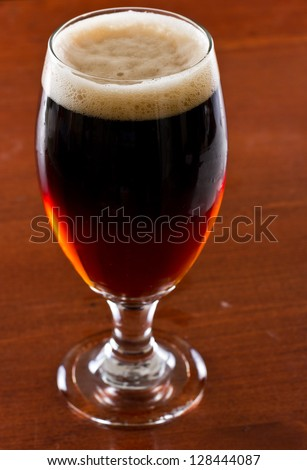 black and tan, half stout half red ale on a bar top - stock photo
