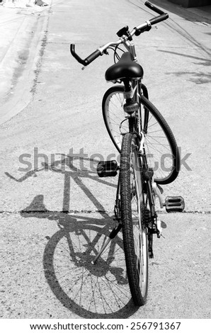 Black and white a bicycle with shadow / Black and white a bicycle  - stock photo