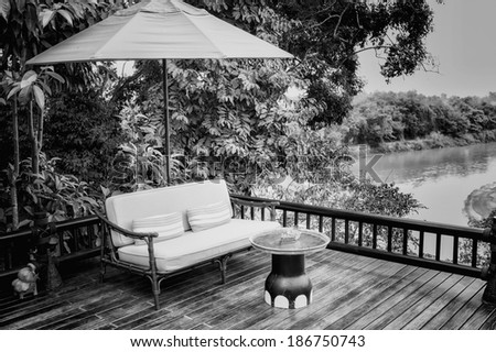 black and white armchairs and river  view on the Terrace - stock photo