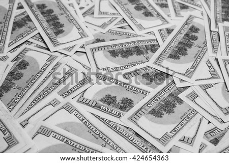 black and white art photography monochrome, background of the money, hundred dollar bills down back reverse side. background of dollars, old hundred-dollar bill - stock photo
