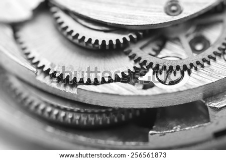 Black and white background with metal cogwheels a clockwork. Conceptual photo for your successful business design. Macro. - stock photo