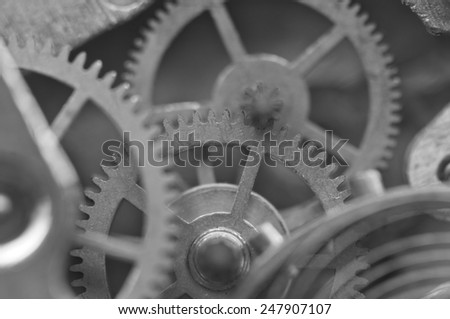 Black and white background with metal cogwheels inside clockwork. Conceptual photo for your successful business design. Macro.  - stock photo