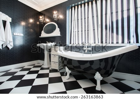 Black and white bathtub in bathroom, horizontal - stock photo