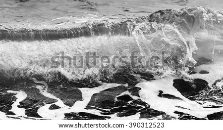 Black and white Beach rock and blue sea in Thailand - stock photo