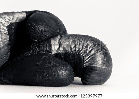 Black and white boxing gloves isolated on white background - stock photo