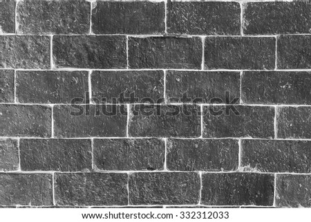 Black and white brick wall abstract background texture. - stock photo