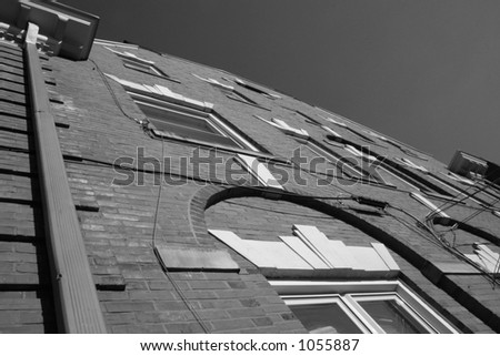 Black and white building wall in the city. - stock photo