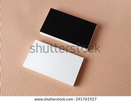 Black and white business cards on color background. Mock-up for branding identity. Top view. - stock photo