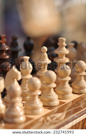 Black and white chess pieces on a chessboard, closeup. Set of chess figures on the playing board - stock photo