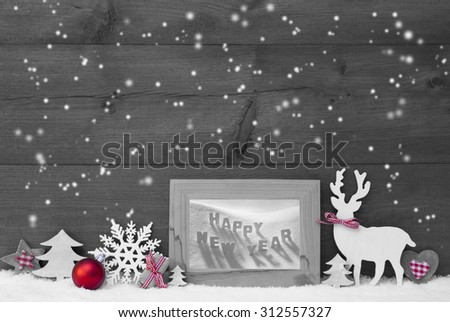 Black And White Christmas Decoration With Reindeer Christmas Trees Snowflakes Red Ball On Snow. Picture Frame With English Text Happy New Year. Christmas Card For Seasons Greetings. Wooden Background - stock photo