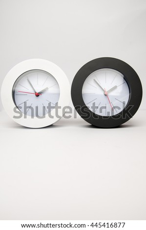 Black and white clock isolated on a white background - stock photo