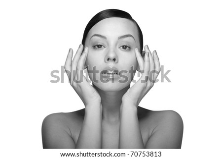 black and white close up a young beautiful brunette girl with hands near her eyes isolated - stock photo