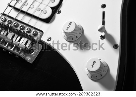 Black and White  close up of electric guitar volume knob.  Please note that this is a player's guitar, not a museum piece - stock photo