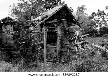 Black and white closeup of a small house that has been all but completely destroyed due to a direct hit from a tornado in Picher, Oklahoma. - stock photo