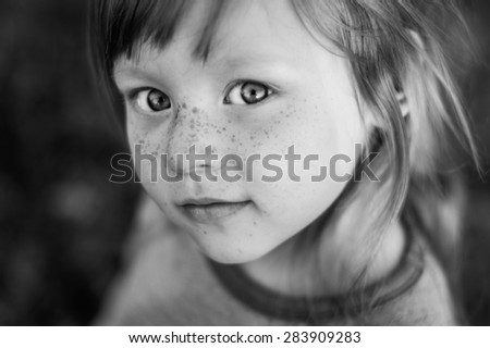 black and white closeup portrait of beautiful girl with big expressive eyes - stock photo