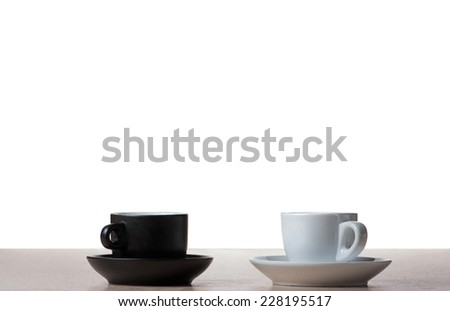 Black and white coffee cup on the table - stock photo