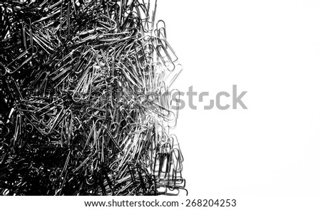 Black and white color background of many paper clip with white background - stock photo