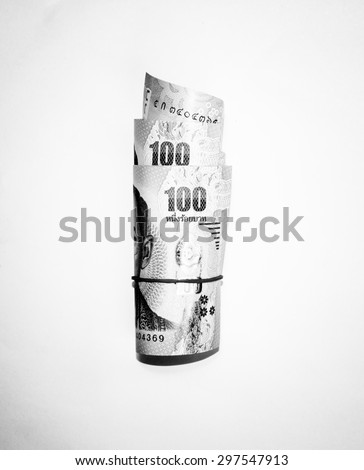 Black and white color of roll one hundred Thai money banknote - stock photo